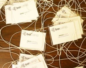 A jumble of conference tags (or labels)
