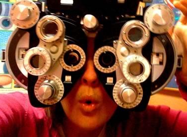 Photo: woman using eye testing equipment