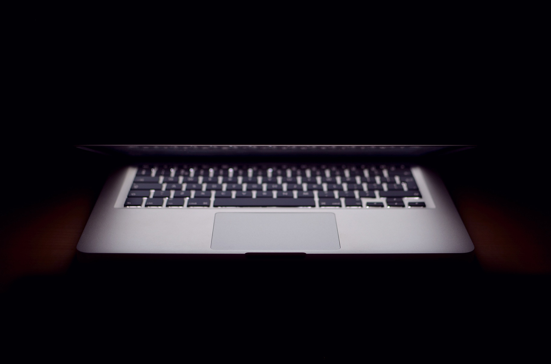 Laptop in the dark with an almost closed lid