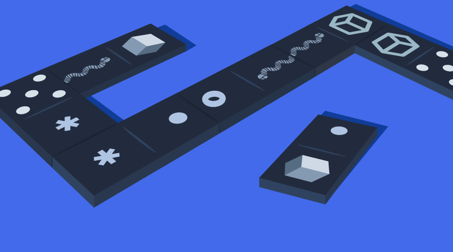 A set of dominoes with symbols representing JavaScript variables and datatypes